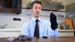 Businessman darning socks Stock Footage