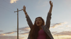 Beautiful Teen Celebrating In A Convertible Against A Blue Cloudscape - stock footage