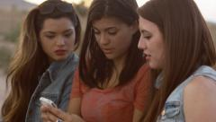 Three Beautiful Teen Girls Looking, Smiling At A Phone Together Stock Footage