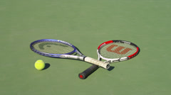 TENNIS RACKETS ON EMPTY COURT (ZOOM OUT) Stock Footage