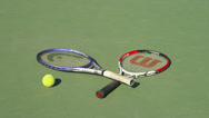 Stock Video Footage of TENNIS RACKETS ON EMPTY COURT (ZOOM OUT)