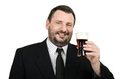 mature man in suit with glass of ale - stock photo