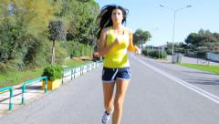 Wide shot of woman running fit body Stock Footage