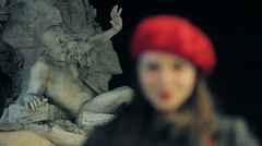 Young smiling woman with red hat in front of the fountain of the four rivers Stock Footage