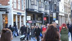Shoppers in eastgate street, chester Stock Footage