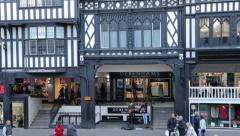 Pan of shoppers at the rows in eastgate street, chester Stock Footage