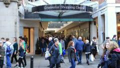 shoppers at grosvenor shopping centre, eastgate street, chester - stock footage