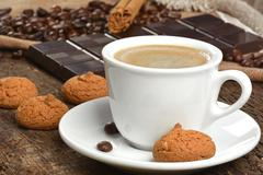 coffee with almond cookies - stock photo
