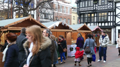 Shoppers at chester christmas market Stock Footage