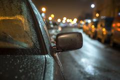 Car in rainy evening Stock Photos