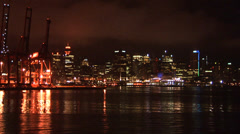 Cargo Cranes and City Lights in Bay Stock Footage