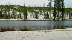 SNOW BY YELLOWSTONE RIVER (PAN) Stock Footage