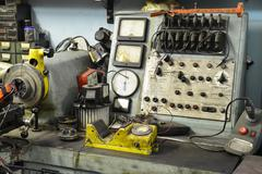 old electro-mechanic tool in a workshop - stock photo