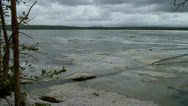 FROZEN YELLOWSTONE RIVER WITH CLOUDS (PAN) Stock Footage