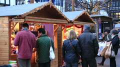 shoppers at chester christmas market - stock footage