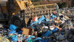 Garbage dump. Bulldozer (tractor) at garbage landfill. 9 - stock footage