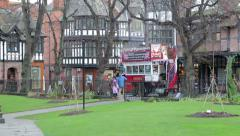 Chester tourist tram bus passes along the street, England Stock Footage