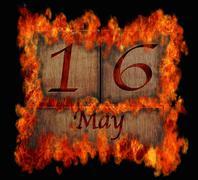 burning wooden calendar may 16. - stock illustration