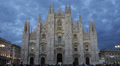 Dusk Light Night People Crowds Walking Passing Milan Duomo Square Cathedral Lit Footage
