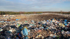 Garbage dump and bulldozer. Landscape of ecological damage - contaminated land. Stock Footage