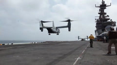 V22 Osprey lands, Aircraft flight operations aboard the USS Iwo Jima Stock Footage