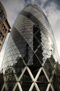 looking up at the gherkin london - stock photo