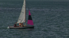 Skiff pink sailboat Stock Footage