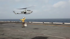 Cobra Helicopter, Aircraft flight operations aboard the USS Iwo Jima Stock Footage