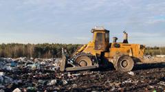 Garbage dump. Bulldozer (tractor) at garbage landfill. 8 Stock Footage