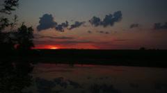 timelapse landscape with sunrise over lake - stock footage