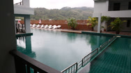 Stock Video Footage of hotel with swimming pool in the rain