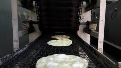 Tortilla machine conveyor with tortillas Stock Footage