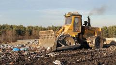 Garbage dump. Bulldozer (tractor) at garbage landfill. 10 Stock Footage