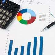 Pen, calculator and business graph Stock Photos