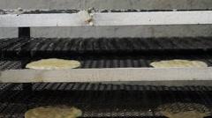 Tortilla machine conveyor with tortillas Stock Footage