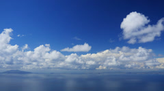 Beautiful seascape, cumulus clouds floating over sea in blue sky, time-lapse. Stock Footage