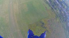 Parachutist aligns trajectory Stock Footage