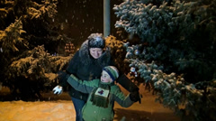 A mother with a son plays snowballs Stock Footage