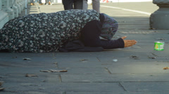 Destitute Woman Begging in the Street Stock Footage