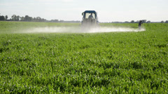 Tractor spray fertilize field with insecticide. farmer meter Stock Footage