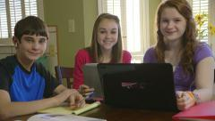 Teenagers studying smile at camera Stock Footage