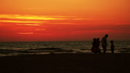 Stock Video Footage of Silhouette of family on the beach at sunset