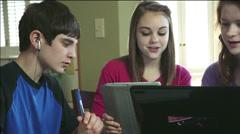 Teenage home study group using technology Stock Footage