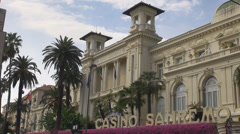 Famous San Remo Sanremo Palace Municipal Casino building facade palm tree sunny  Stock Footage