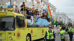 Gay lesbian parade drive open bus street Stock Footage