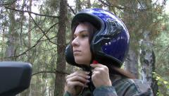 Pretty girl in the rider's helmet Stock Footage