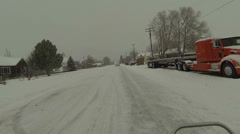 Riding ATV rural town snow storm icy roads POV HD 0225 Stock Footage