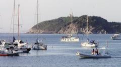 Sailboats at anchor in mediterranean sea Stock Footage