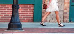 Affluent female shopper. - stock photo