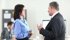 Two business people chatting Stock Footage